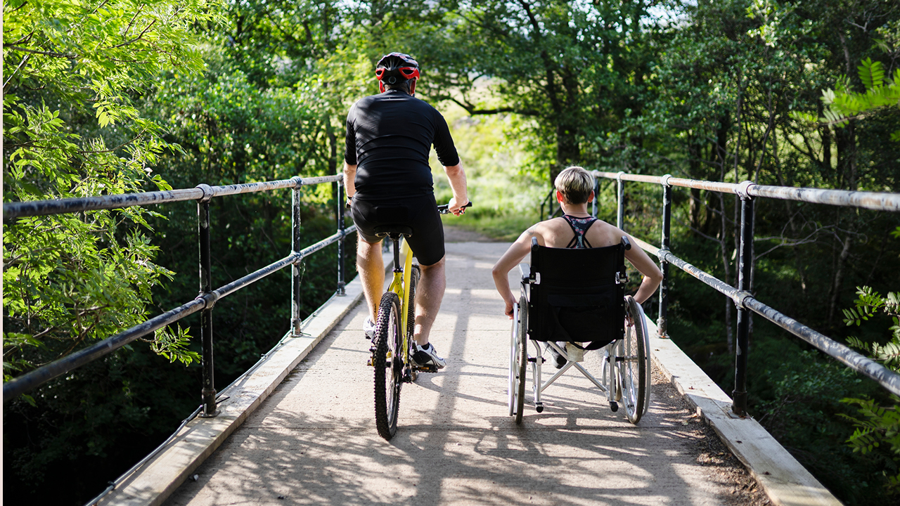 Couple exercising bicycle wheelchair